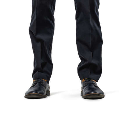 dominacion: Front view of cropped legs of a businessman isolated on white background. Business staff. Office clothes. Big feet. Domination and superiprity. Foto de archivo