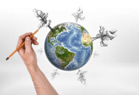 image size: A mans hand drawing trees of different size with a pencil around the globe on the white background. Ecology and health. Creativity and art. Environmental issues. Elements of this image are furnished by NASA.