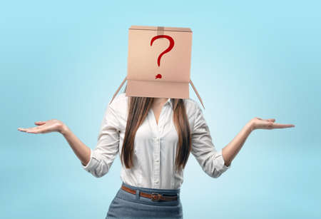 hypocrisy: Businesswomen wearing carton box on her head with drawn red question mark.