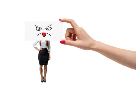 the requirement: Small businesswoman and giant hand covering her face with piece of paper
