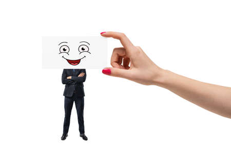 Big womans hand is putting a smiley face on white cartoon on an employees head isolated on white background