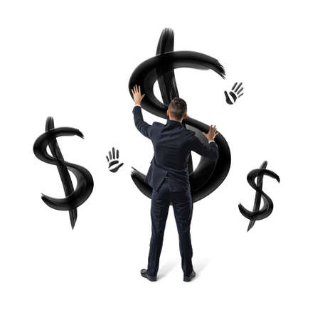 Businessmen on white background placing hands on black painted dollar signs and hand prints. Stock Photo