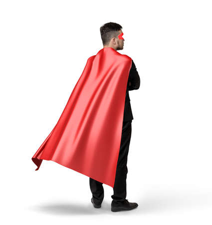 A lone businessman in red flowing cape in side 45 degrees view on white background. Stock Photo