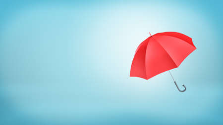 safe water: An open classic red umbrella with a handle vertically placed on blue background.