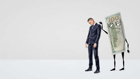 A sad businessman being assured by a large dollar bill with arms and legs that pats the mans back.