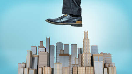 A giant male shoe ready to stomp at a small cluster of business towers on blue background.
