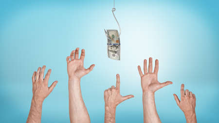 Many pointing, grabbing, greeting male hands aiming for a dollar bill caught on a hook. Everyone likes money. Best offer sale. Financial motivation. Stock Photo