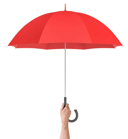 A male hand holds a large classic red umbrella with an open canopy and a black curved handle. Stock Photo