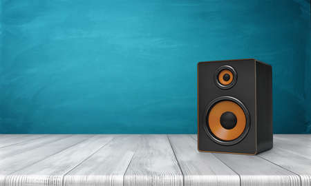 3d rendering of a one black speaker box with orange trim standing on a wooden table in front of a blue background. Фото со стока