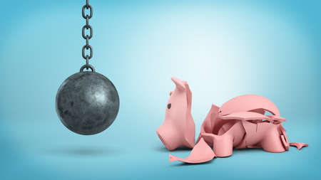 3d rendering of a resting wrecking ball on a chain hangs near a cracked piggy bank on blue background.