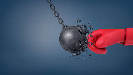 3d rendering of swinging wrecking ball crashes when collides with a huge red boxing glove. Stock Photo