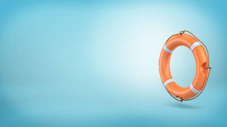 3d rendering of a single orange life buoy with a rope over its sides stands vertically on a blue background. Stock Photo