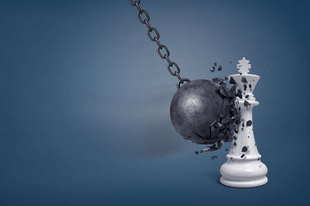 3d rendering of a large wrecking ball breaks in small pieces when it hits a white chess king. Stock Photo