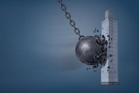 3d rendering of giant iron wrecking ball breaks in pieces when it hits a business skyscraper.