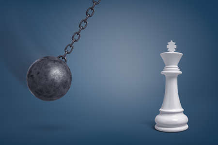 3d rendering of a giant wrecking ball swings in the direction of a large white chess king.