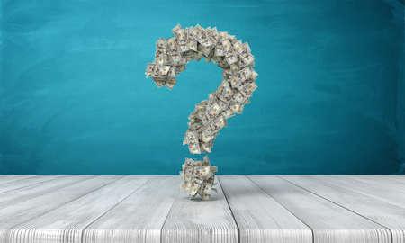 Representación 3D de un signo de interrogación hecho de muchos billetes de dólar colgando sobre un escritorio de madera. ¿Dónde está el dinero? Cómo hacerse rico. Cuestión de dinero.