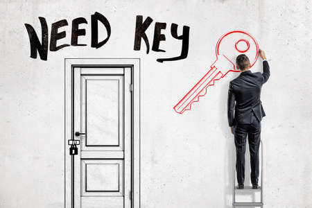 A man in suit standing on a ladder to the right of a locked door with the title Need Key above and drawing a key on a wall Banque d'images - 114369204