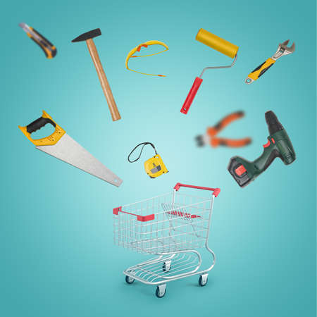 3d rendering of a shopping cart standing on the floor and various DIY supplies scattering in all directions. Banco de Imagens