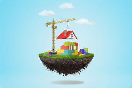 3d rendering of a building crane putting a roof on lego house on a piece of land in the air on blue sky background Stock Photo