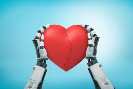 View from above of black and white robot hands holding big red Valentine heart cracked in half on light blue background.