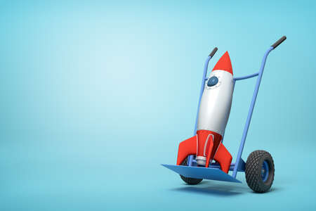 3d rendering of toy space rocket on blue hand truck which is standing in half-turn on light-blue background with copy space. 写真素材