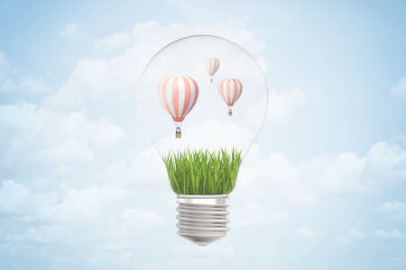 3d rendering of hot air balloons inside of light bulb on blue background Banco de Imagens