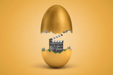 3d rendering of movie clapper hatching out of golden egg on yellow background