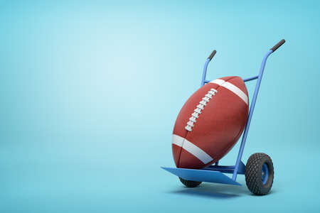 3d rendering of big brown gridiron ball on blue hand truck on light-blue background with copy space. 写真素材