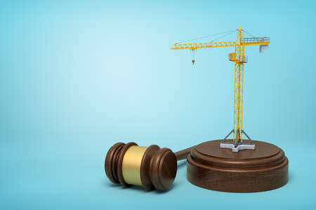 3d rendering of small construction crane standing on sounding block with judge gavel beside the block on light-blue background.