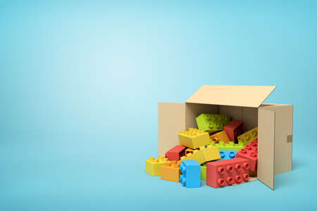 3d rendering of cardboard box lying sidelong full of colorful toy bricks on blue background. Stok Fotoğraf