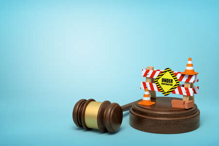 3d rendering of construction barrier on round wooden block and brown wooden gavel on blue background