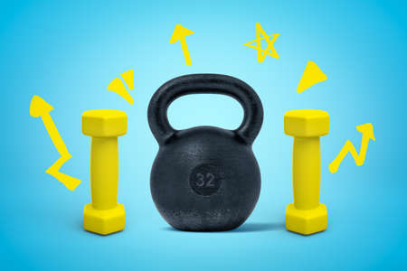 3d rendering of black kettlebell and two yellow dumbbells on blue background Banco de Imagens