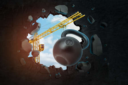 3d rendering of hoisting crane carrying black kettlebell and breaking black wall leaving hole in it with blue sky seen through. Banco de Imagens