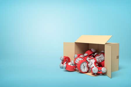 3d rendering of cardboard box lying sidelong full of bent deformed alarm clocks on blue background. Stock Photo