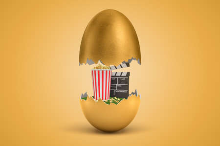 3d rendering of gold egg cracked in two, upper half levitating in air, popcorn bucket and clapperboard on green grass in lower half.