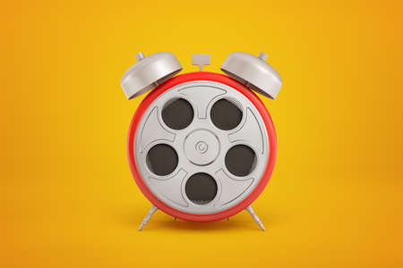 3d close-up rendering of red round alarm clock with silver-grey retro film reel instead of clock-face on amber background. Reklamní fotografie