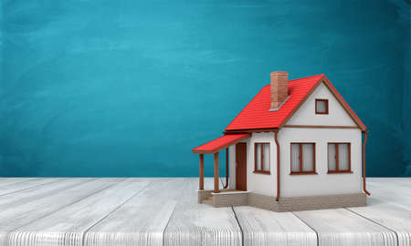 3d rendering of small one-stores house standing on wooden floor near blue wall with some copy space. Stockfoto