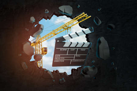 3d rendering of construction crane and movie clapper breaking black wall Standard-Bild - 129484993