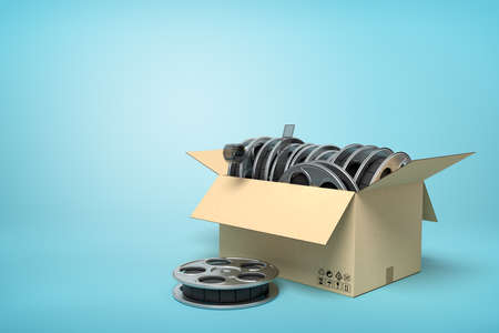 3d rendering of cardboard box full of film reels with one reel beside box on light-blue background with copy space. Standard-Bild - 129485088