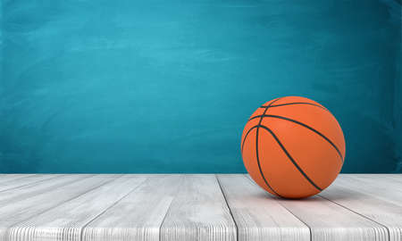 3d rendering of a basketball on wooden surface near blue wall. Banco de Imagens