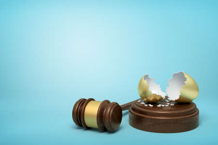 3d rendering of broken golden eggshell on round wooden block and brown wooden gavel on blue background Banco de Imagens
