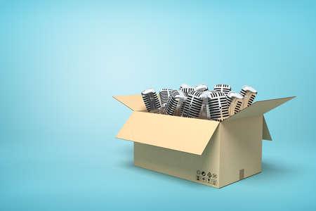 3d rendering of cardboard box full of microphones on blue background. Banco de Imagens