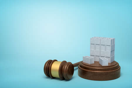 3d rendering of stack of grey hollow bricks on sounding block with judge gavel lying beside on light-blue background.