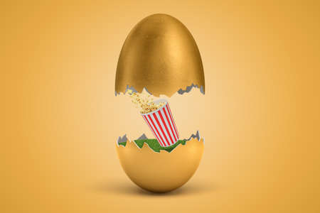 3d rendering of striped popcorn bucket that has hatched out of golden egg.