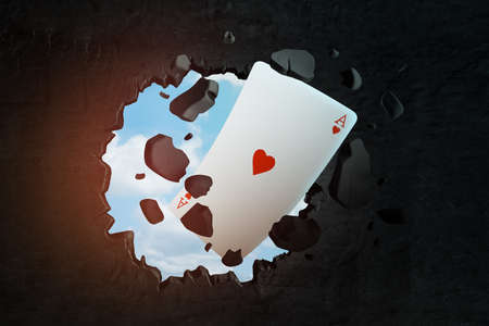 3d rendering of playing ace heart card breaking black wall Фото со стока - 130509788