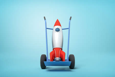 3d rendering of toy space rocket on blue hand truck which is standing in half-turn on light-blue background with copy space. Stockfoto