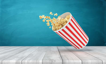 3d rendering of popcorn bucket on wooden surface near blue wall with copy space.