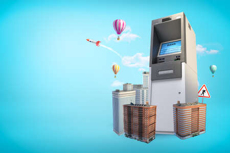 Gigantic ATM rising amid high-rise buildings on blue background with copy space. Business and finance. Payment methods. Modern lifestyle.