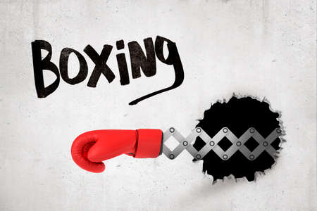 3d rendering of concrete wall with title Boxing, and black hole and red boxing glove popping out of it.