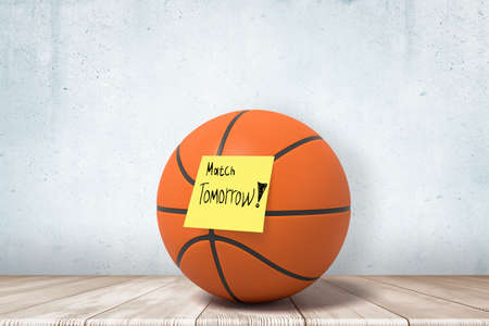 3d close-up rendering of a basketball on wooden floor, with yellow sticky note on ball that reads Match tomorrow Banco de Imagens
